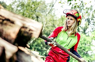 Young Lumberjack Woman Stacking the Timbers