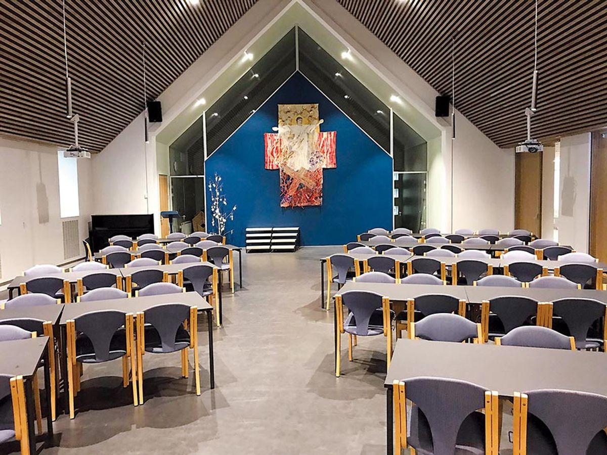 Dette var tidligere kirkerommet, men er nå totalrenovert og brukes til menighetssal. Foto: Kristiansand kommune