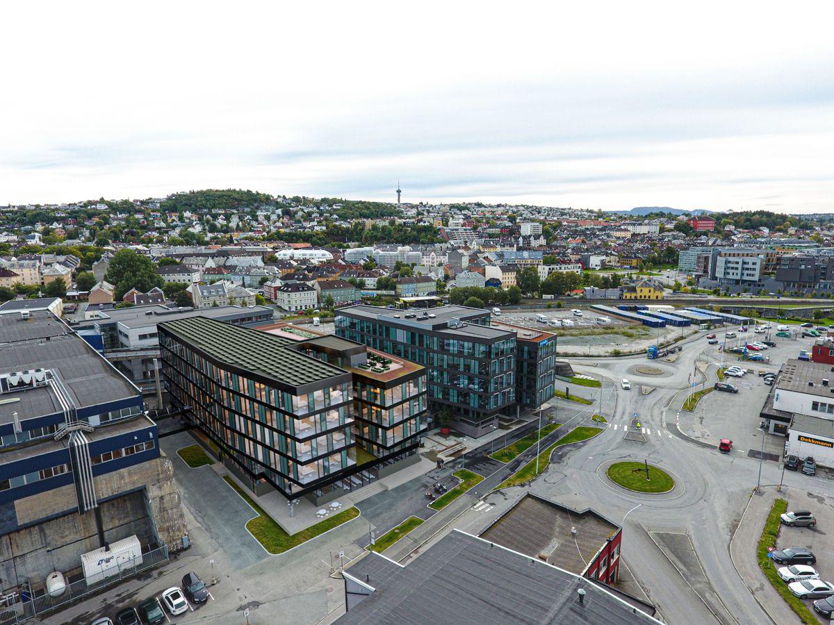 3D-illustrasjon over NyhavnaEN, med det ferdigstilte byggetrinn 1 til høyre og byggetrinn 2 til høyre. Illustrasjon: Rambøll/ Vizwork