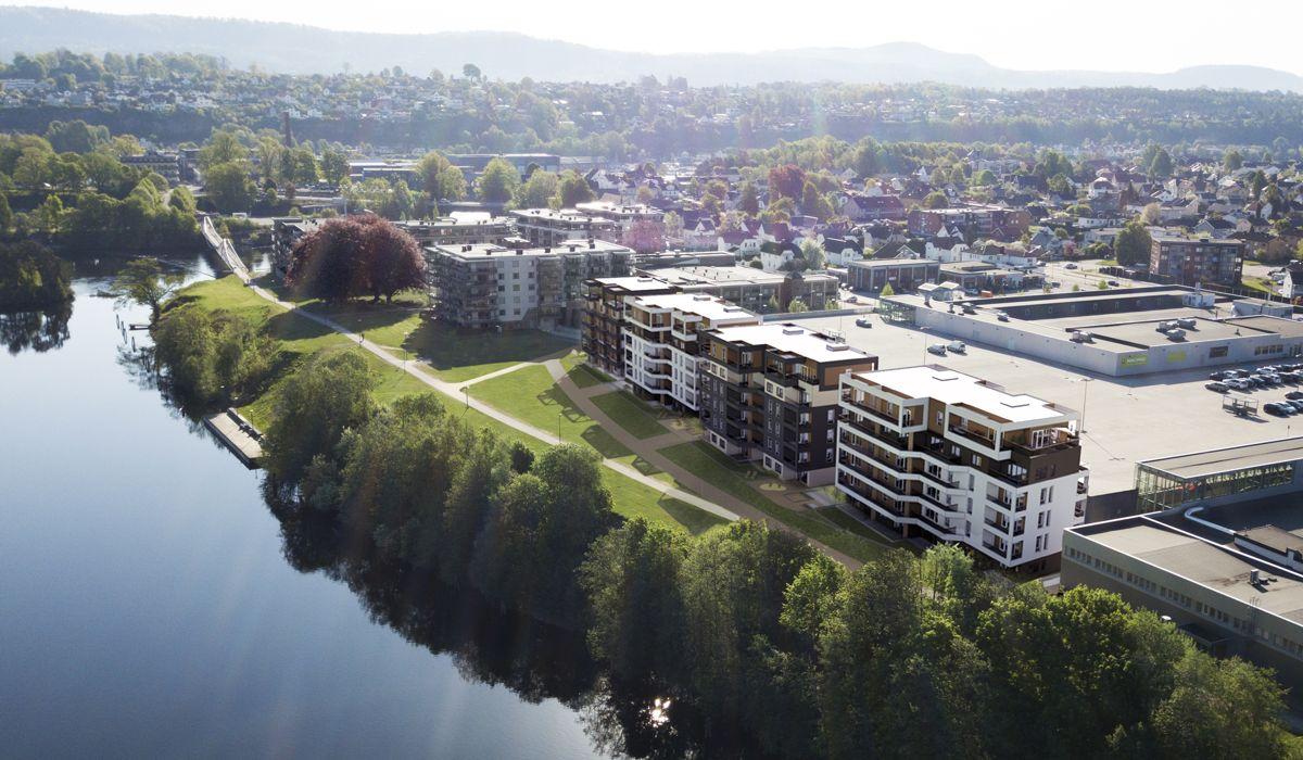 På Herkules Park skal det bygges totalt 85 boliger fordelt på fire leilighetsbygg, rett ved Hjellevannet i Skien. Illustrasjon: Arkitektkontoret Point.