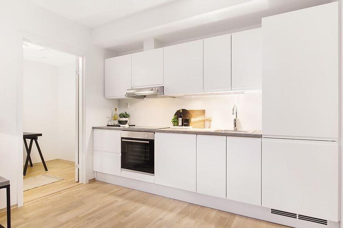 Kjøkkenløsning i en av leilighetene. Foto: Veidekke
