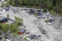 RASERT NABOLAG: Alle husker 22. mai 2013 godt. Et helt land følte med innbyggerne i den lille bygda Kvam i Gudbrandsdalen, der flommen i løpet av få timer hadde ødelagt mange hjem.