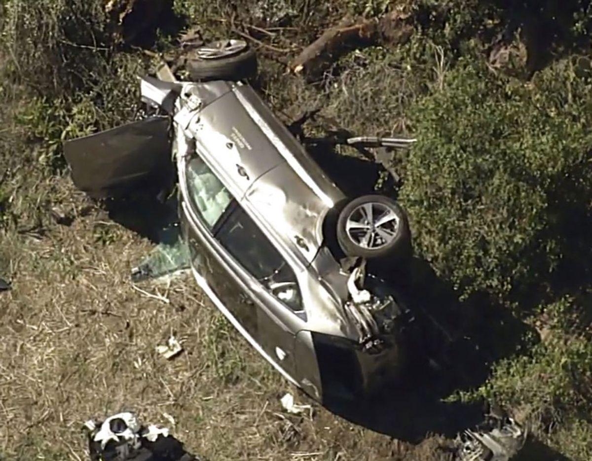 Bilen fik voldsomme skader. Det samme gjorde Tiger. Klik for mere. Foto: Uncredited/Scanpix