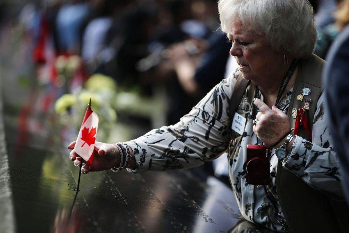 Ofre og pårørende var inviteret til en mindeceremoni ved Ground Zero. Foto: Spencer Platt/Scanpix.
