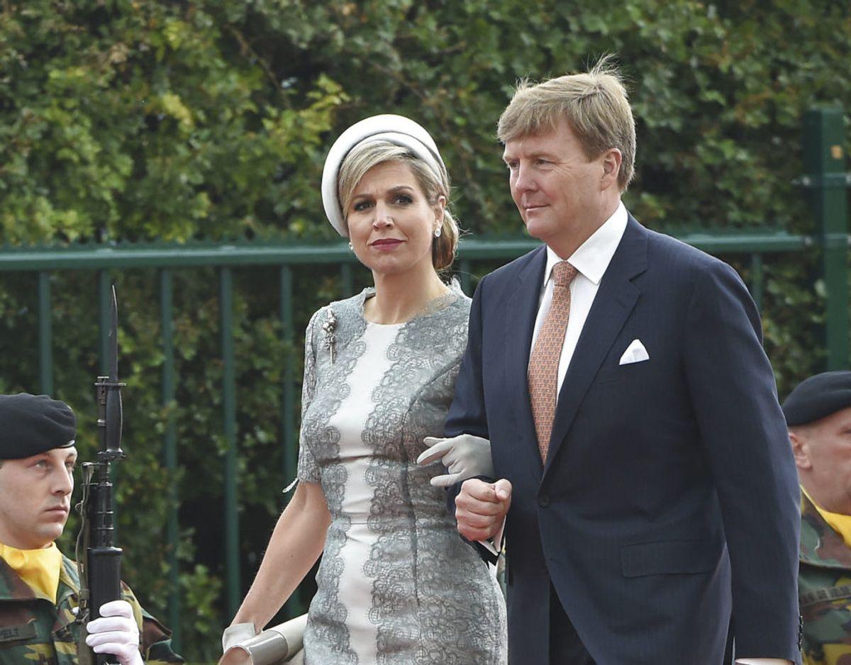 Det Hollandske kongepar, kong Willem-Alexander og dronning Maxima. Klik videre for at se billeder fra de voldsomme uroligheder. Foto: Scanpix/REUTERS/John Thys/Pool