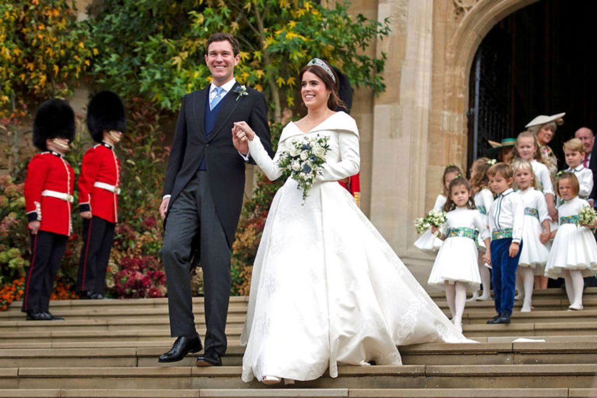 Princess Eugenie and her new husband Jack Brooksbank outside St George's Chapel in Windsor Castle following their wedding, Britain October 12, 2018. Victoria Jones/Pool via REUTERS