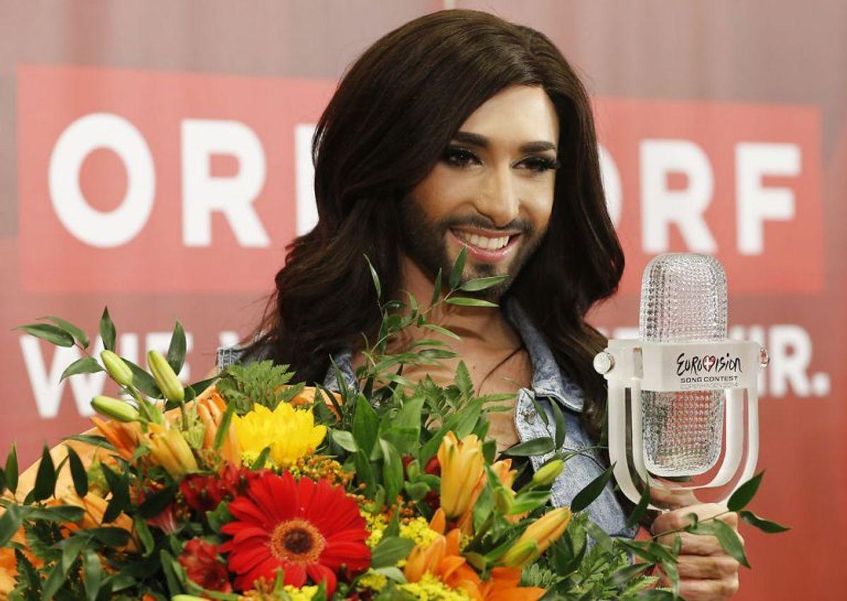 """2014: Østrigs Conchita Wurst vandt på Refshaleøen i København med sangen """"Rise Like a Phoenix"""". Foto: Leonhard Foeger/Scanpix (Arkivfoto)"""